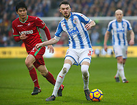 Huddersfield Town's Scott Malone gets away from Swansea City's Ki Sung-Yueng<br /> <br /> Photographer Alex Dodd/CameraSport<br /> <br /> The Premier League - Huddersfield Town v Swansea City - Saturday 10th March 2018 - John Smith's Stadium - Huddersfield<br /> <br /> World Copyright &copy; 2018 CameraSport. All rights reserved. 43 Linden Ave. Countesthorpe. Leicester. England. LE8 5PG - Tel: +44 (0) 116 277 4147 - admin@camerasport.com - www.camerasport.com