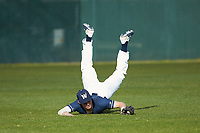 Wingate Bulldogs left fielder Andrew Motsinger (7) makes a diving catch during the game against the Concord Mountain Lions at Ron Christopher Stadium on February 1, 2020 in Wingate, North Carolina. The Bulldogs defeated the Mountain Lions 8-0 in game one of a doubleheader. (Brian Westerholt/Four Seam Images)