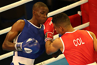 BARRANQUILLA - COLOMBIA, 25-07-2018: MARTINEZ MEZA Jhon W. (Colombia) vs JONES Ajayi Taiwo (Barbados) durante su participación en boxeo masculino categoría gallo (56kg) como parte de los Juegos Centroamericanos y del Caribe Barranquilla 2018. /  MARTINEZ MEZA Jhon W. (Colombia) vs JONES Ajayi Taiwo (Barbados) during their participation in the boxing men's bantam (56kg) category of the Central American and Caribbean Sports Games Barranquilla 2018. Photo: VizzorImage / Cont