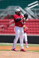 Carolina Mudcats starting pitcher Marcos Diplan (18) looks to his catcher for the sign against the Winston-Salem Dash at Five County Stadium on May 14, 2017 in Zebulon, North Carolina.  The Mudcats walked-off the Dash 11-10.  (Brian Westerholt/Four Seam Images)