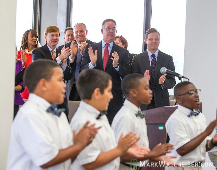 Adam Putnam, Florida Commissioner of Agriculture, background left, Jeff Atwater, Florida Chief Financial Officer, center, and Florida Lt Governor Carlos Lopez-Cantera, clap along with the Tallavana Christian School as they sing during a prayer rally on the National Day of Prayer on the 22nd floor of the Florida Capitol in Tallahassee, Florida.