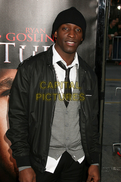 "ELIJAH KELLEY .""Fracture"" Los Angeles Premiere at Mann's Village Theatre, Westwood, California, USA..April 11th, 2007.half length black suit jacket hat grey gray cardigan .CAP/ADM/BP.©Byron Purvis/AdMedia/Capital Pictures"