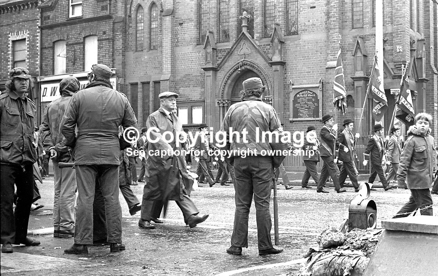 Local UDA, Ulster Defence Association, members watch as the Belfast Twelfth Parade passes Shankill Road Methodist Church. At least two of them are carrying baseball bats. 12th July 1972. 197207120422c <br /> <br /> Copyright Image from Victor Patterson, 54 Dorchester Park, Belfast, UK, BT9 6RJ<br /> <br /> Tel: +44 28 9066 1296<br /> Mob: +44 7802 353836<br /> Voicemail +44 20 8816 7153<br /> Email: victorpatterson@me.com<br /> Email: victorpatterson@gmail.com<br /> <br /> IMPORTANT: My Terms and Conditions of Business are at www.victorpatterson.com