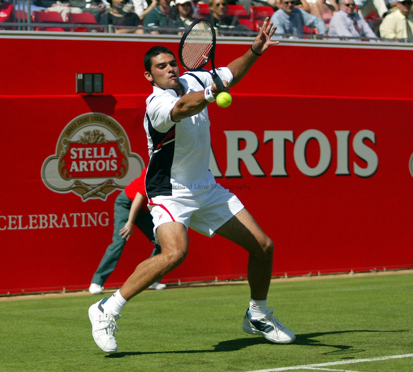 Photograph: Scott Heavey..Day 1 of the Stella Artois Championship at the Queens Club. 09/06/2003..Mark Philippoussis