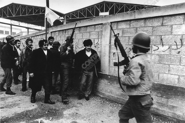 Palestinian men over the age of fourteen rounded up by Christian gunmen. Within hours they were all murdered and their bodies burned. Karantina massacre, Beirut, Lebanon, January 18, 1976