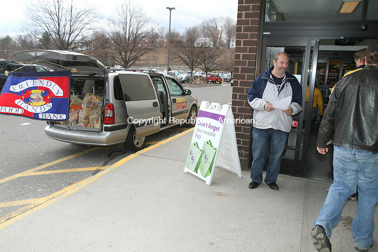 TORRINGTON, CT - 2 April, 2011 - 040211MO02 - Rick E. Dalla Valle, a longtime volunteer at Friendly Hands Food Bank, hoped to collect 1,000 items Saturday during a food drive at the Stop & Shop on High Street. By 12:30 p.m., 750 items had been collected, along with an uncounted amount of cash. Another drive will be held April 23 at Price Chopper, 9 a.m. to 3 p.m. Jim Moore Republican-American.