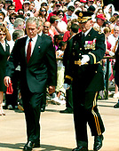 Washington, D.C. - May 29, 2006 -- United States President George W. Bush is escorted to a wreath laying ceremony at the Tomb of the Unknowns at Arlington National Cemetery in Arlington, Virginia  by the Commandant of the Military District of Washington (MDW) Major General Guy C. Swann III on May 29, 2006.  The President and first lady were at Arlington for the annual Memorial Day Commemoration honoring fallen American heroes.<br /> Credit: Ron Sachs  - Pool via CNP