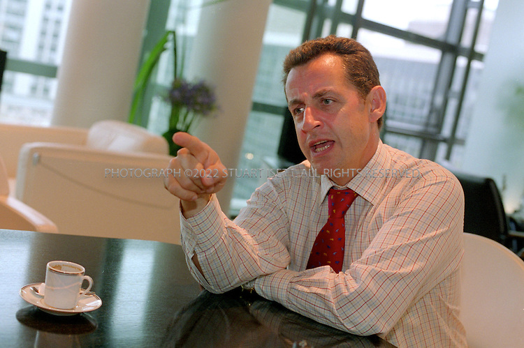9/27/2004--Paris, France..French politician Nicolas Sarkozy, the son of Hungarian immigrants, in his offices at the French Finance Ministry. In November 2004, Sarkozy will leave his position as Finance Minister to head the  Union for the Presidential Majority Party (UMP), the party of French President Jacques Chirac...Photograph by Stuart Isett.©2004 Stuart Isett. All rights reserved