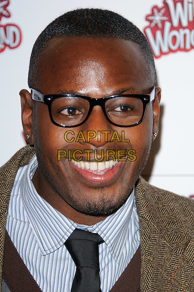 BEN OFOEDU.The Winter Wonderland in Hyde Park Corner VIP preview, London, England..November 18th, 2010.headshot potrtait brown blue glasses smiling facial hair .CAP/CJ.©Chris Joseph/Capital Pictures.