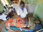 Marieta Carlo, a midwife, examines Susan Peter's abdomen at the St. Daniel Comboni Catholic Hospital in Wau, South Sudan.