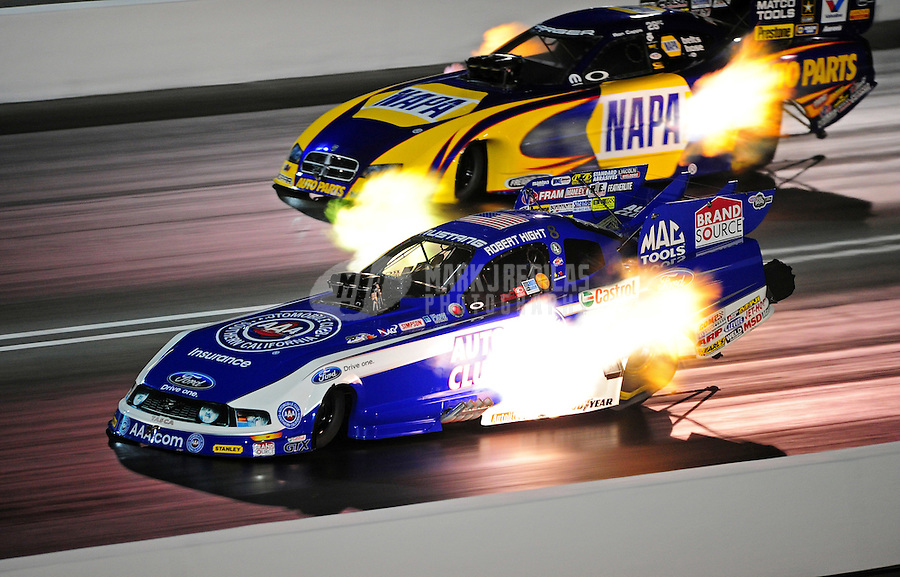 Jun. 17, 2011; Bristol, TN, USA: NHRA funny car driver Robert Hight (near) alongside Ron Capps during qualifying for the Thunder Valley Nationals at Bristol Dragway. Mandatory Credit: Mark J. Rebilas-