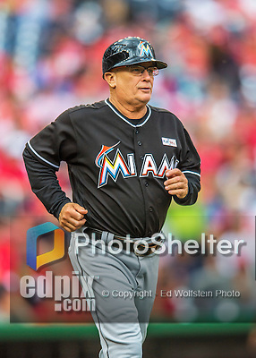 14 May 2016: Miami Marlins first base coach Perry Hill trots to his position during the first game of a double-header against the Washington Nationals at Nationals Park in Washington, DC. The Nationals defeated the Marlins 6-4 in the afternoon matchup.  Mandatory Credit: Ed Wolfstein Photo *** RAW (NEF) Image File Available ***