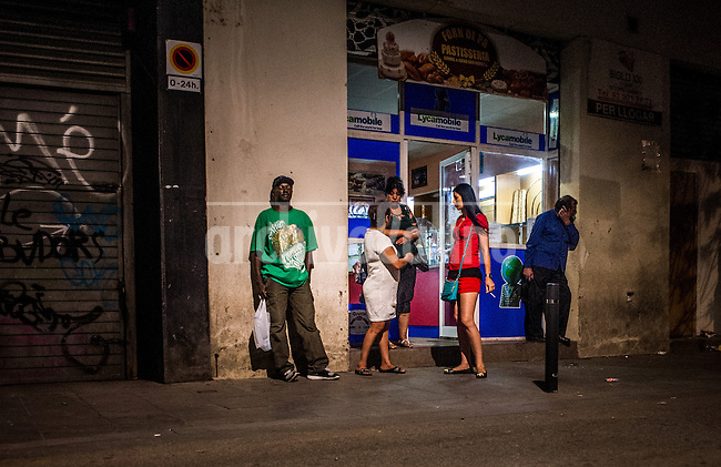 Barcelona-Jul-2013.Prostitutes in Raval, Barcelona.Despite being one of the richest cities in Spain, Barcelona has a poverty rate of around 18%. This figure is even worsening, due to an economic crisis that has pushed up unemployment in Spain to 27%.