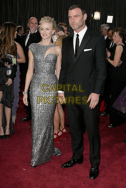 Naomi Watts (wearing Armani Prive) & Liev Schreiber  .85th Annual Academy Awards held at the Dolby Theatre at Hollywood & Highland Center, Hollywood, California, USA..February 24th, 2013.oscars full length  gunmetal grey gray sequins asymmetrical sequined liquid glittering gown with cutout neckline stubble facial hair holding hands dress metallic black suit couple .CAP/ADM.©AdMedia/Capital Pictures.