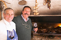 Daniel Pisano one of the brothers Pisano and The barbecue cook in front of the fire supervising the meat on the grill. Bodega Pisano Winery, Progreso, Uruguay, South America