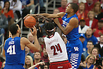 Guard Aaron Harrison of the Kentucky Wildcats blocks a shot during the game against  the Louisville Cardinals at KFC Yum! Center on Saturday, December 27, 2014 in Louisville `, Ky. Kentucky defeated Louisville 58-50. Photo by Michael Reaves | Staff