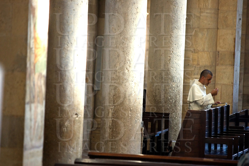 Un frate prega dentro l'abbazia di Sant'Antimo.<br /> A friar prays inside the abbey of Sant'Antimo.<br /> UPDATE IMAGES PRESS/Riccardo De Luca