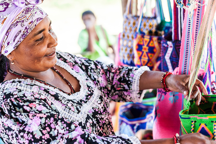 Wayuu indigenous woman showing handcrafts in a Wayuu Rancheria, or rural settlement, in La Guajira, Colombia.  Knitting, crocheting and weaving are fundamental to the social and economic lives of Wayuu women in La Guajira, Colombia.