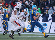 Annapolis, MD - December 28, 2017: Navy Midshipmen quarterback Zach Abey (9) scores a touchdown during the game between Virginia and Navy at  Navy-Marine Corps Memorial Stadium in Annapolis, MD.   (Photo by Elliott Brown/Media Images International)