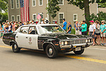 4th of July parade- Madison, CT . Vintage police car.