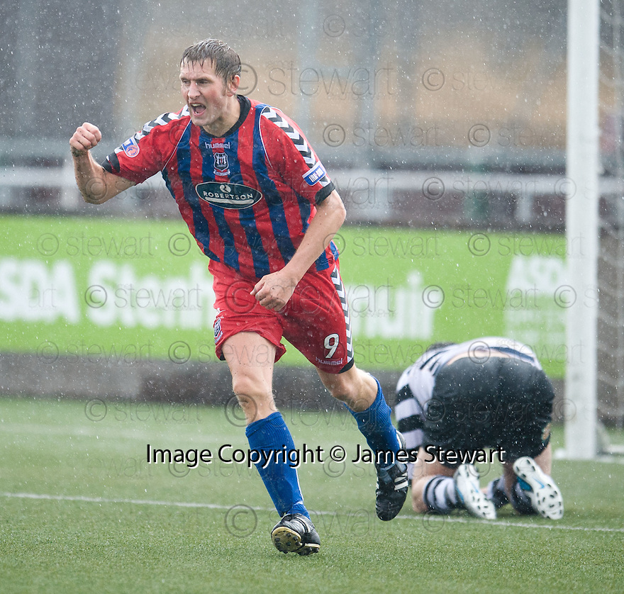 Dennis Wyness celebrates after he scores Elgin's fourth.