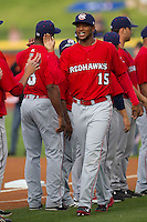 Oklahoma City Redhawks outfielder Domingo Santana #15 is introduced before the Pacific Coast League baseball game against the Round Rock Express on April 3, 2014 at the Dell Diamond in Round Rock, Texas. The Redhawks defeated the Express 7-6 in the season opener for both teams. (Andrew Woolley/Four Seam Images)
