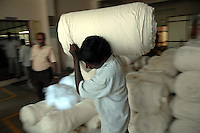 Loads of raw material at Prime Tex Ltd. a garment factory in Tirupur, Tamilnadu. After lifting of quota system in textile export on 1st january 2005. Tirupur has become the biggest foreign currency earning town of India.