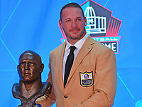 Canton, OH - August 4, 2018: Former Chicago Bears linebacker  Brian Urlacher poses with his bust after delivering his Pro Football Hall of Fame enshrinement speech at the Tom Benson Hall of Fame Stadium in Canton, Ohio, August 4, 2018. Urlacher finished his career as the Bears'' all-time leading tackler. (Photo by Don Baxter/Media Images International)