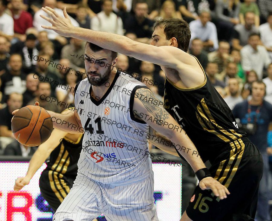 Kosarka, Euroleague, sezona 2011/2012.Partizan Vs. Real Madrid.Nikola Pekovic and Mirza Begic, right.Belgrade, 10.11.2011..foto: Srdjan Stevanovic/Starsportphoto ©