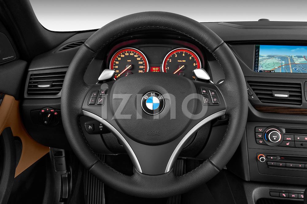 Steering wheel view of a 2012 Bmw X1 xDrive20d 5 Door Suv 2WD
