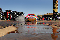 Apr 17, 2009; Avondale, AZ, USA; NASCAR Sprint Cup Series driver Reed Sorenson drives through a puddle in the garage during practice for the Subway Fresh Fit 500 at Phoenix International Raceway. Mandatory Credit: Mark J. Rebilas-