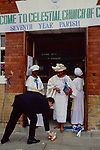 Celestial Church of Christ. Woshipers at 'Cele' must leave their shoes at the entrance to the church (Exodus 3, 5 )  As Mrs Ojara wife of Chief Ojara leaves the Seventh Year parish in Londons East End. Her chauffeur  deferentially returns her shoes.