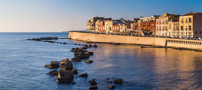 Panoramic photo of colourful Sicilian houses on Ortigia Island at sunrise, Syracuse (Siracusa), Sicily, Italy, Europe. This is a panoramic photo of colourful Sicilian houses on Ortigia Island at sunrise, Syracuse (Siracusa), Sicily, Italy, Europe.