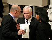United States Sedcretary of the Treasury Henry Paulson, left, Secretary of Defense William Gates, center, and Secretary of State Condoleezza Rice share a discussion prior to the State Funeral for former United States President Gerald R. Ford at the Washington National Cathedral, in Washington, D.C. on Tuesday, January 2, 2007..Credit: Ron Sachs / CNP.[NOTE: No New York Metro or other Newspapers within a 75 mile radius of New York City].