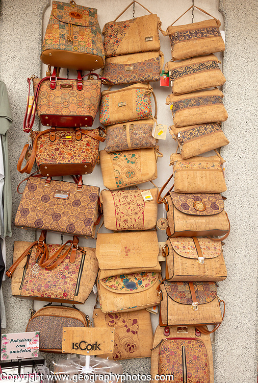 Close up of shop display of handbags made from cork oak souvenir products of butterflies and fish on sale, city of Evora, Alto Alentejo, Portugal, southern Europe