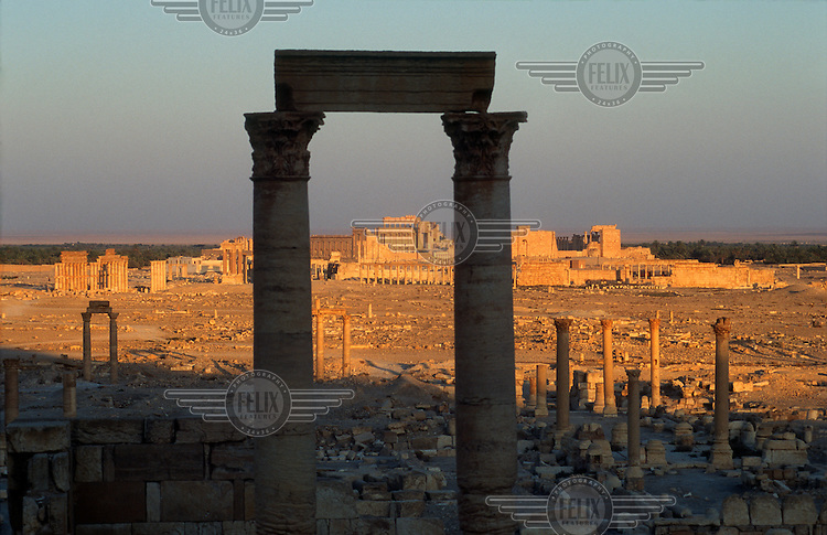 General view of the ancient ruins of Palmyra with the oasis and the desert behind. Palmyra (or Tadmor in Arabic) dates back to the Neolithic period and was first mentioned in the second millennium BC as a caravan stop. It later came under the Seleucid Empire and then under the Roman Empire.<br /> In May 2015 Islamic State (IS) forces fighting the Syrian government of President Assad took control of the modern settlement of Tadmur and the historic site. There are fears that the priceless treasures could fall victim to IS's iconoclastic destruction that has seen museums and ancient sites across Syria and Iraq destroyed.