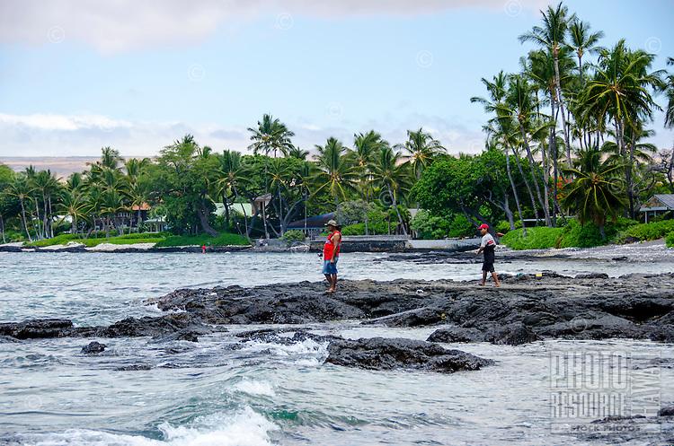 Two local fisherman at a beach in Puako, South Kohala, Hawai'i Island.