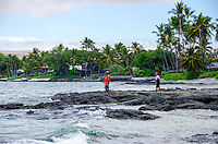 Two local fisherman at a beach in Puako, South Kohala, Hawai'i Island.