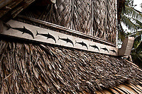 Dolphins on custom men's house, Yap Micronesia (Photo by Matt Considine - Images of Asia Collection)