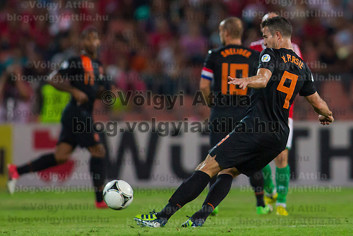 Netherlands' Robin van Persie kicks the ball during a World Cup 2014 qualifying soccer match Hungary playing against Netherlands in Budapest, Hungary on September 11, 2012. ATTILA VOLGYI