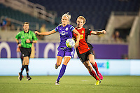 Orlando, Florida - Sunday, May 14, 2016: Orlando Pride midfielder Kaylyn Kyle (6) shields the ball away from Western New York Flash midfielder Samantha Mewis (5) during a National Women's Soccer League match between Orlando Pride and New York Flash at Camping World Stadium.