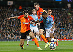 Raheem Sterling of Manchester City is challenged by Taras Stepanenko and Serhiy Kryvtsov of Shakhtar Donetsk during the UEFA Champions League match at the Etihad Stadium, Manchester. Picture date: 26th November 2019. Picture credit should read: Darren Staples/Sportimage