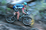 A mountain bike racer speeds down a section of singletrack at the Lake Chelan Mountain Bike Festival in Washington State.