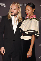 LOS ANGELES, CA - NOVEMBER 04: Actor Zoe Saldana (R) and artist Marco Perego attend the 2017 LACMA Art + Film Gala Honoring Mark Bradford and George Lucas presented by Gucci at LACMA on November 4, 2017 in Los Angeles, California.<br /> CAP/ROT/TM<br /> &copy;TM/ROT/Capital Pictures