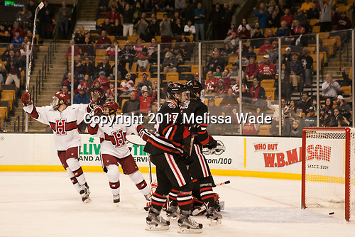 Sean Malone (Harvard - 17), Nathan Krusko (Harvard - 13) - The Harvard University Crimson defeated the Northeastern University Huskies 4-3 in the opening game of the 2017 Beanpot on Monday, February 6, 2017, at TD Garden in Boston, Massachusetts.