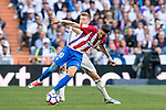 Yannick Ferreira Carrasco of Atletico de Madrid battles for the ball with Toni Kroos of Real Madrid during their La Liga match between Real Madrid and Atletico de Madrid at the Santiago Bernabeu Stadium on 08 April 2017 in Madrid, Spain. Photo by Diego Gonzalez Souto / Power Sport Images