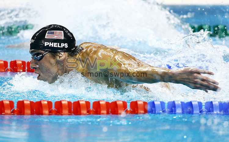 PICTURE BY VAUGHN RIDLEY/SWPIX.COM...Swimming - 14th FINA World Championships 2011- Oriental Sports Centre, Shanghai, China - 26/07/11...USA's Michael Phelps competes in the Men's 200m Butterfly Semi-Finals.