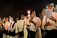 "Suore durante una fiaccolata in Piazza San Pietro, nel cinquantesimo anniversario dell'apertura del Concilio Vaticano II e del ""Discorso alla Luna"", in Vaticano, 11 ottobre 2012..Nuns attend a torchlight procession in St. Peter's square, to mark the 50th anniversary of the opening of the Second Vatican Council and of the ""Speech to the Moon"", at the Vatican, 11 october 2012..UPDATE IMAGES PRESS/Riccardo De Luca"