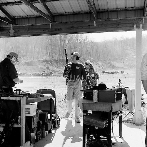 Machine Gun Shoot<br /> Knob Creek<br /> Westpoint, Kentucky<br /> USA<br /> April 5, 2009<br /> <br /> Nearly 16,000 people attend the Knob Creek Machine Gun Shoot &amp; Military Gun Show. It is the largest gathering of Civilian owned machine guns in the world. The gun show has over 700 tables with machine guns, military surplus, ammo, hard to find parts &amp; pieces and regular firearms and supplies.<br /> <br /> Firearms sales have surged in the six months since Obama's election as millions of Americans have gone on a buying spree that has stripped gun shops in some parts of the country almost bare of assault weapons and led to a national ammunition shortage.<br /> <br /> The FBI says that since November more than seven million people applied for criminal background checks in order to buy weapons, a figure excluding the many more buying at thousands of gun shows in states such as Virginia, without facing any checks.<br /> <br /> Gun-shop owners and the National Rifle Association say the surge is driven by worries that Obama is planning to ban many types of firearms and that the deepening economic crisis will fuel a crime wave, as witnessed by the string of mass shootings in the past few weeks.<br /> <br /> But control groups pressing for greater control on firearms accuse the NRA of funding a massive scare campaign to portray Obama as a gun owner's worst nightmare and to argue that tighter restrictions on weapons ownership are a threat to broader liberties and a step toward tyranny.