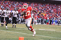 Chiefs running back Larry Johnson runs around the left end for a 12-yard touchdown during the third quarter against the Jacksonville Jaguars at Arrowhead Stadium in Kansas City, Missouri on December 31, 2006. The Chiefs won 35-30.